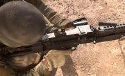 Рюкзак для пулеметчика  с гибким рукавом подачи патронов.